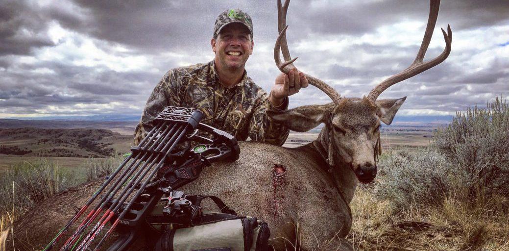Scott Carroll with a Spot and stalk archery mule deer.